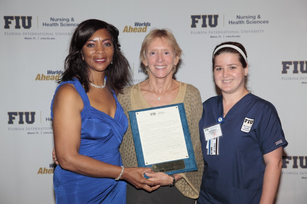 Dr. Ora Strickland (far left), Dean of the College of Nursing and Health Sciences, with Kim Greene (middle), Executive Director of the Dr. John T. Macdonald Foundation, and Naiviv Hernandez (far right), at the Donors and Scholars Luncheon in October 2011.