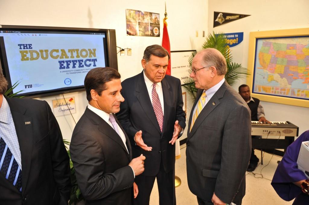 MDCPS Superintendent Alberto Carvalho, JPMorgan Chase Florida Chairman Mel Martinez and FIU President Mark B. Rosenberg discuss The Education Effect at the check presentation in September 2011.