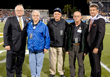 From left to right: FIU President Mark B. Rosenberg, Arlene and Paul Felsberg, John D. Webster, and Executive Director of Sports and Entertainment Pete Garcia at the FIU vs. FAU football game on November 12, 2011. During halftime, the Felsbergs and Webster were recognized for their transformative gifts to the Michael Felsberg Scholarship Endowment in support of FIU Athletics.