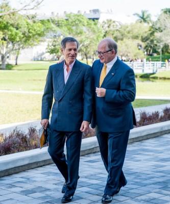 Steven J. Green, left, with FIU President Mark B. Rosenberg