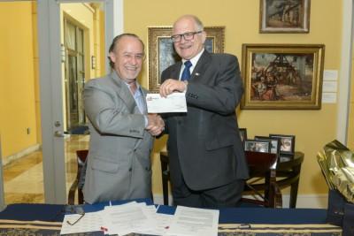"Joseph ""Pepe"" Badia, president of Badia Spices, Inc. and FIU President Mark B. Rosenberg"