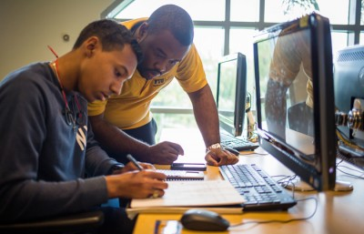 Garfield Jugar is one of 168 Learning Assistants at FIU helping other students in peer mentoring. Jugar works in FIU's Mastery Math Lab.