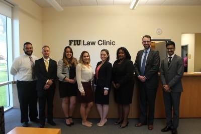 From left to right: Attorney Karim Batista; FIU Law students Anthony Monico; Claudia Cobreiro, Alexis Gonzalez, Krystin Montersil; Senior Associate Dean Michelle Mason; attorney Carlos Gonzalez; and FIU Law student Michael Lowe.