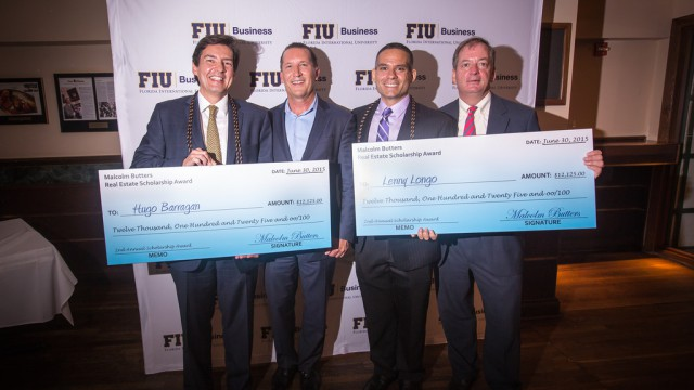 Hugo R. Barragan and Lenny Longo, newly graduated from the Master of Science in International Real Estate program, are presented with the Malcolm Butters Real Estate Scholarship Awards by Malcolm Butters and William G. Hardin.