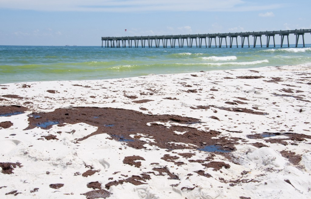 Oil covered sand is shown on June 23, 2010 in Pensacola Beach, Fla.