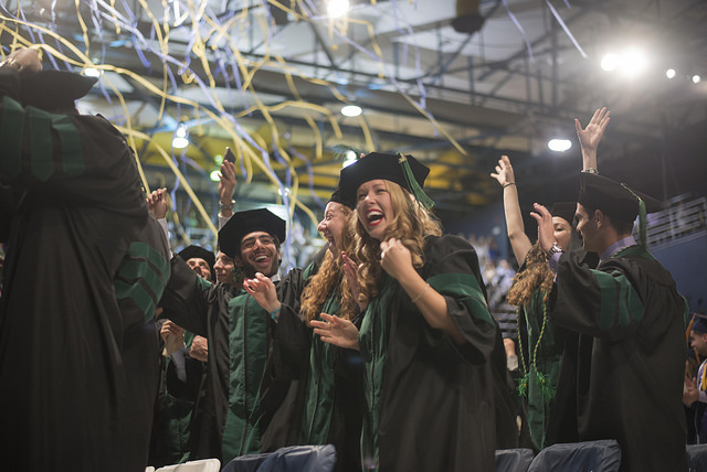 The new doctors celebrate during their commencement ceremony.