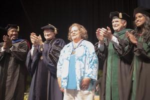 From left to right: Luther Brewster, Ph.D.; President Mark B. Rosenberg; Manolina Sosa; Dr. John A. Rock; and Dr. Manju Korattiyil.